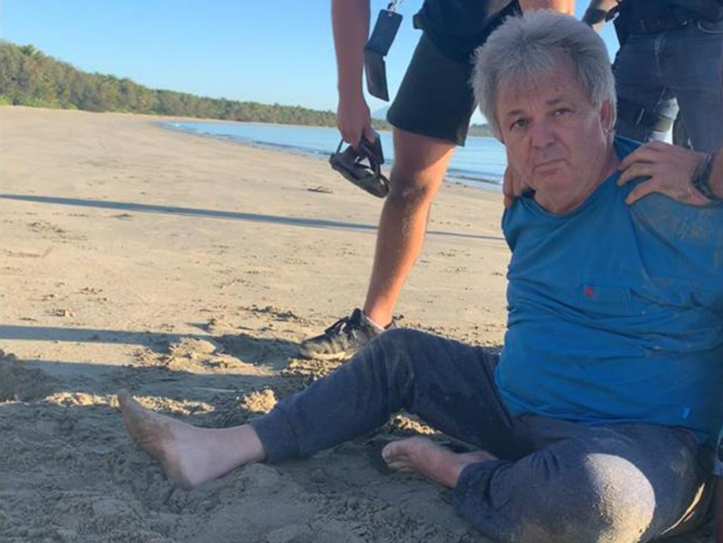 Mr Foster's dramatic arrest in Queensland last year involved him being crash-tackled by officers on a Port Douglas beach. Picture: IFW Global