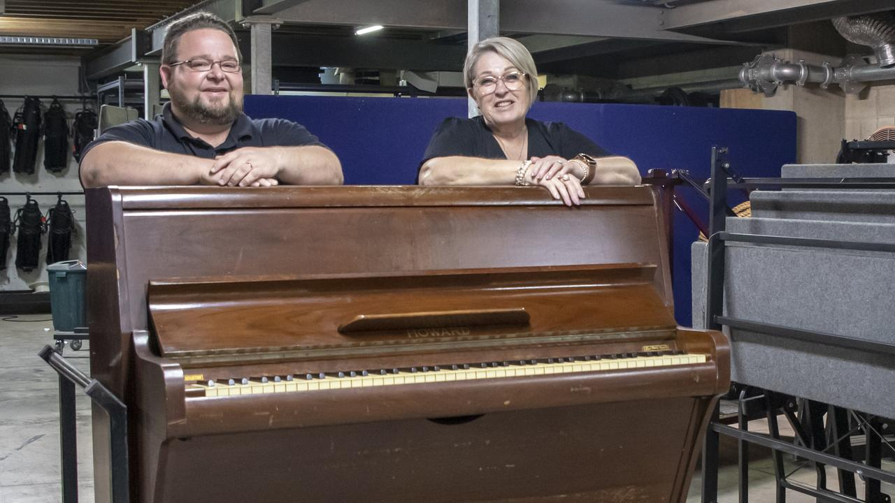 MECC technical services coordinator Steve Newitt and Mackay Regional Councillor Fran Mann with the upright piano from the 1950s that has been donated to Clancy Morgan as a public piano. Picture: Contributed
