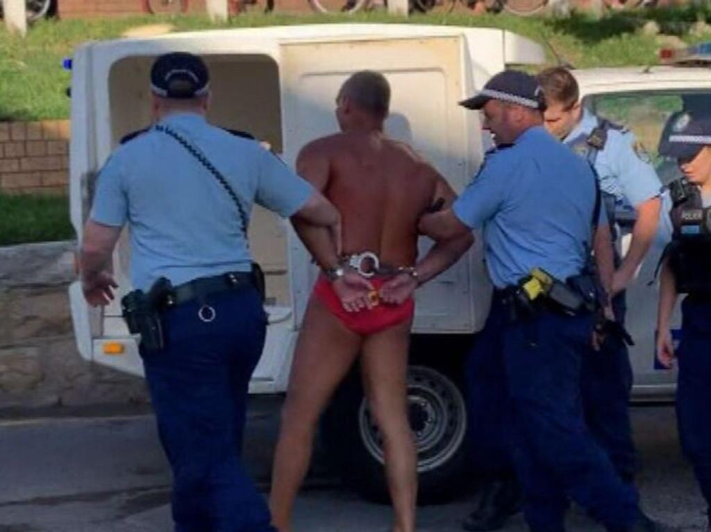 A man was arrested at Bondi Beach after allegedly being spotted walking through an area cordoned off due to public health measures. Picture: 9News