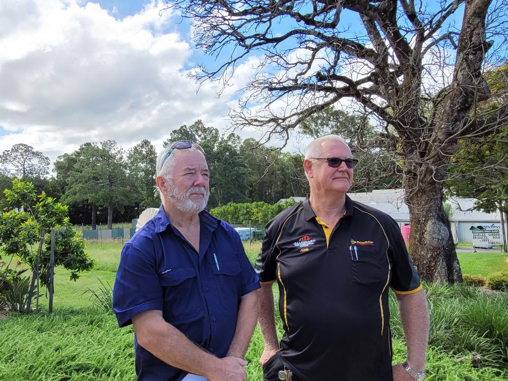 Yandina District Community Association president Nigel Anns and Chamber of Commerce president John O'Leary outside of a vacant block of land where a service station development is proposed. Picture: Matty Holdsworth