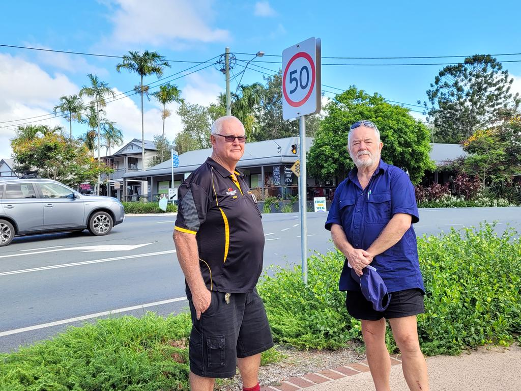 Yandina Chamber of Commerce president John O'Leary and Yandina District Community Association president Nigel Anns outside of a vacant block of land where a service station development is proposed.