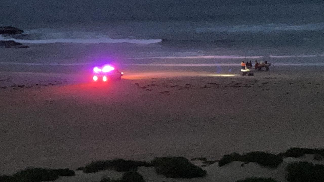 Emergency services personnel at Hill 60 near Fishermans Beach, Port Kembla, on Friday night.