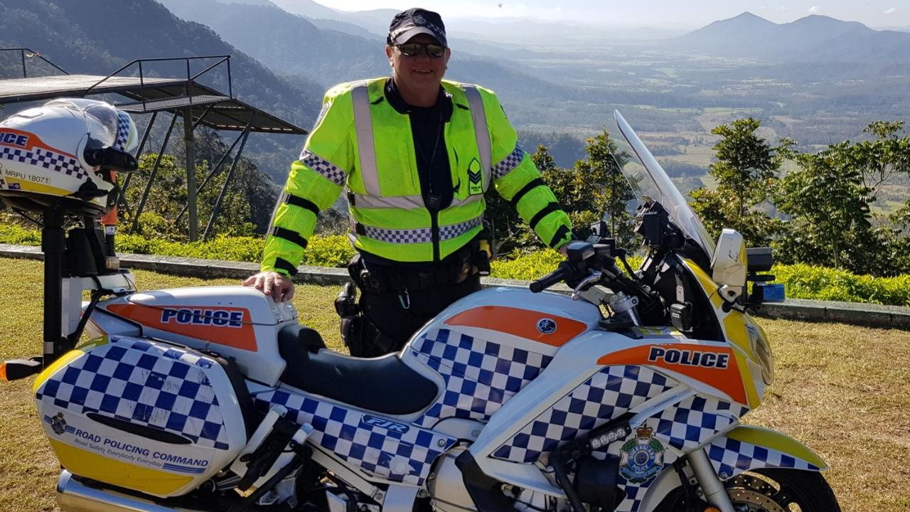 Mackay Road Policing Unit Sergeant Simon Robinson with his bike at the top of Eungella Range. Picture: Queensland Police Service.