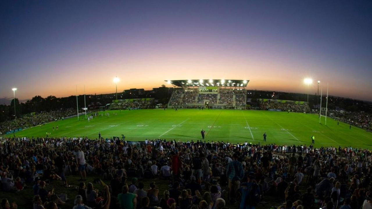 The Sunshine Coast Stadium lit up with a full crowd.