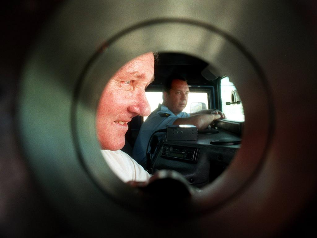 Former Qld police Minister Russell Cooper and officer Mark Fritz inside the prison's new armoured Hummer vehicle at Sir David Longland Correctional Centre in 1998. The cars were purchased in the aftermath of the Abbott escape. Picture: Nathan Richter