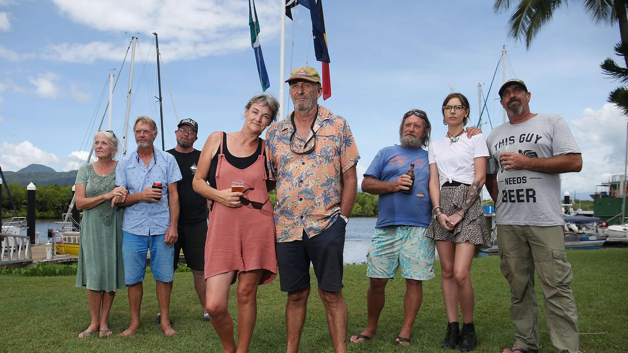 Members of the Cairns Cruising Yacht Squadron at Portsmith are mourning the loss of former club commodore and life member Andy Heard, who was suspected to be taken by a saltwater crocodile near Cardwell. Club members Trish Kay, Dale Williams, Jason Hedges, Dayna Russell, club commodore John Stewart, Andy Murray, Ebonee Read and Paul Roxson comfort each other in front of flags flying at half mast.