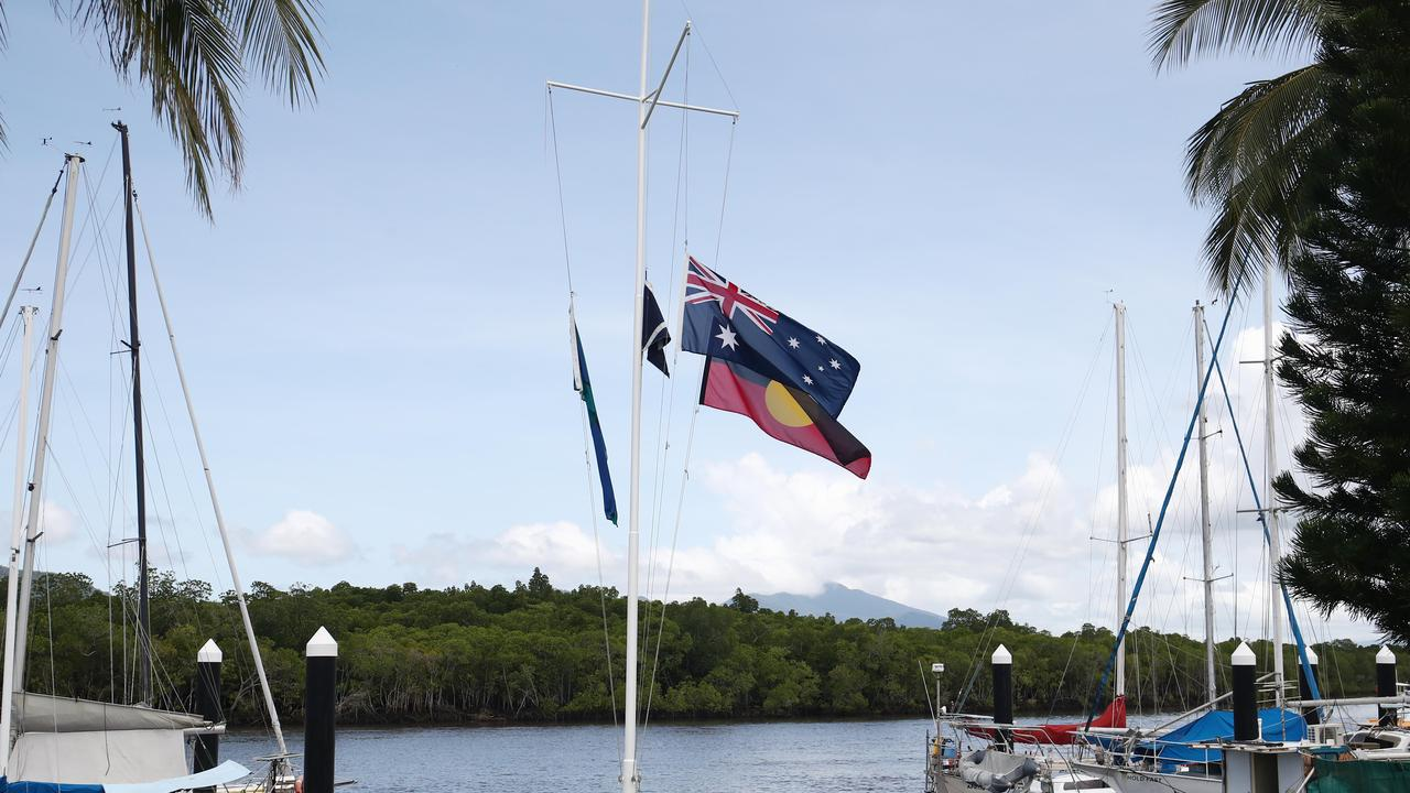 Members of the Cairns Cruising Yacht Squadron at Portsmith are mourning the loss of former club commodore and life member Andy Heard, who was suspected to be taken by a saltwater crocodile near Cardwell. Flags fly at half mast at the club. Picture: Brendan Radke