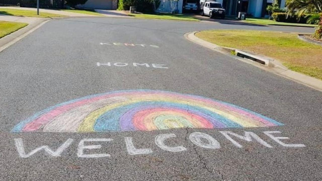 The words 'Welcome home Kents' were written on the family's street on their return to Yeppoon.