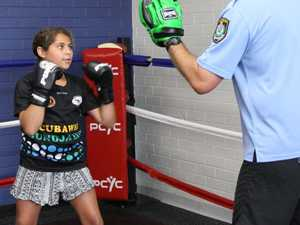 Break down barriers by sparring with a cop
