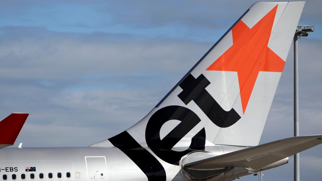 Generic Jetstar aircraft at Sydney airport. Jet star, plane.