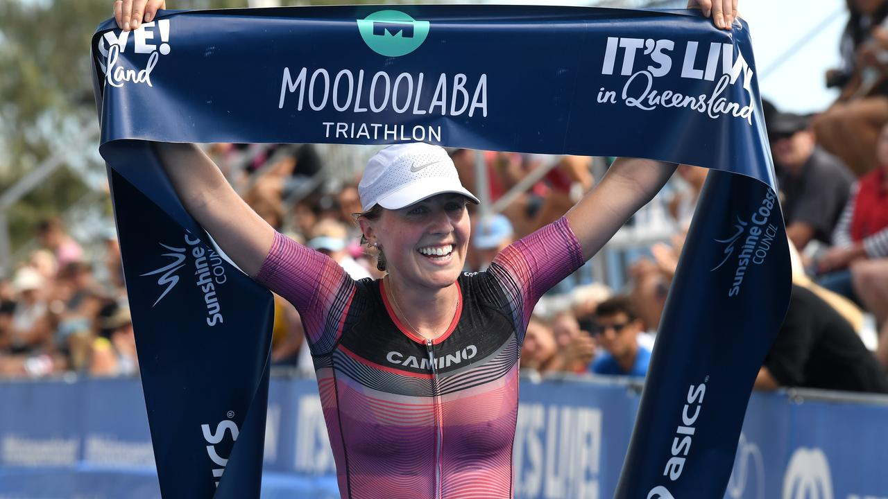 Joanna Brown crosses in first place for the women during last year's Mooloolaba Triathlon.