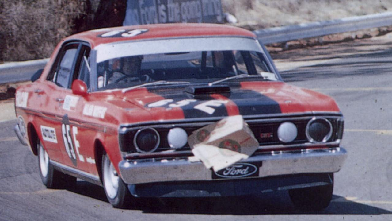 The Falcon GTHO was built to win at Bathurst. Pictured is Allan Moffat driving to victory with cardboard box covering his radiator in 1971. Picture: Supplied