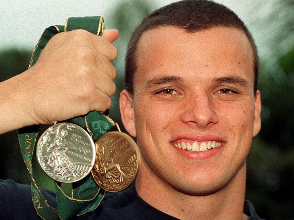 Miller with his bronze and silver medals from the 1996 Atlanta Games.