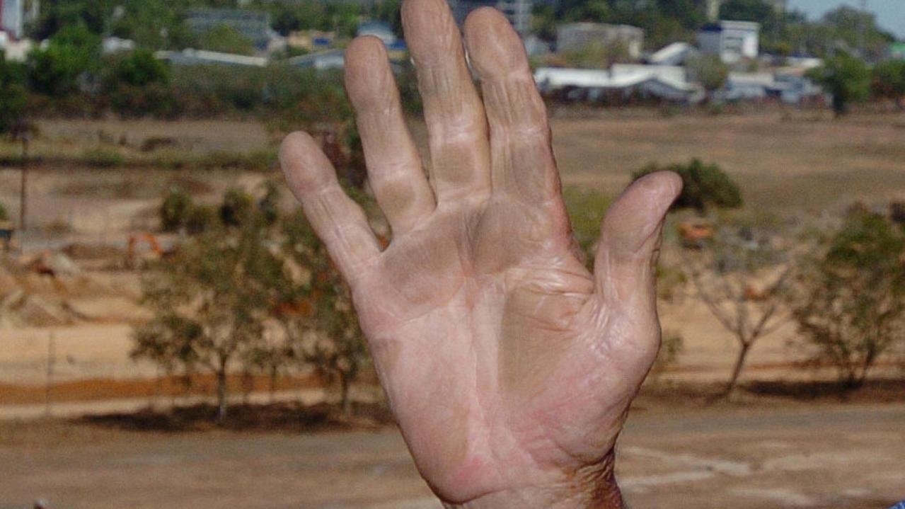 An image of dust on a person's hand from a nearby worksite.