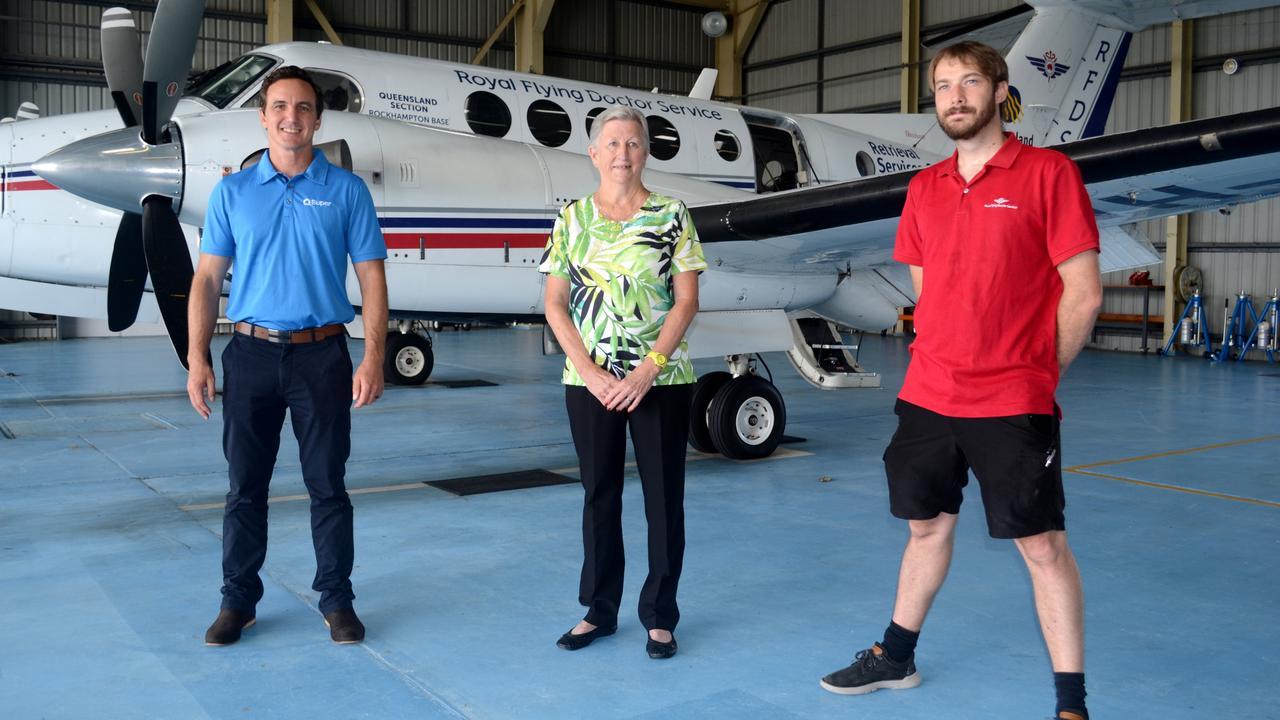 QSuper's Paul Charalambous, Christine Cameron and RFDS' Nicholas Coleman-Hicks at the Rockhampton hangar