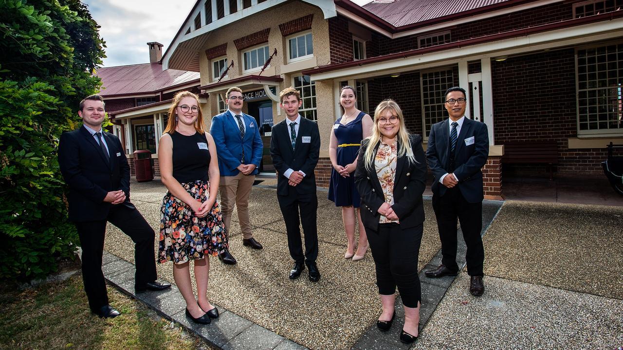 USQ law students Blair Stuart, Erin Lowry, Tory Webb, Jaidyn Paroz, Madelyn Dawson, Julia Keating and Bonifacio Arriabs outside Grace House.