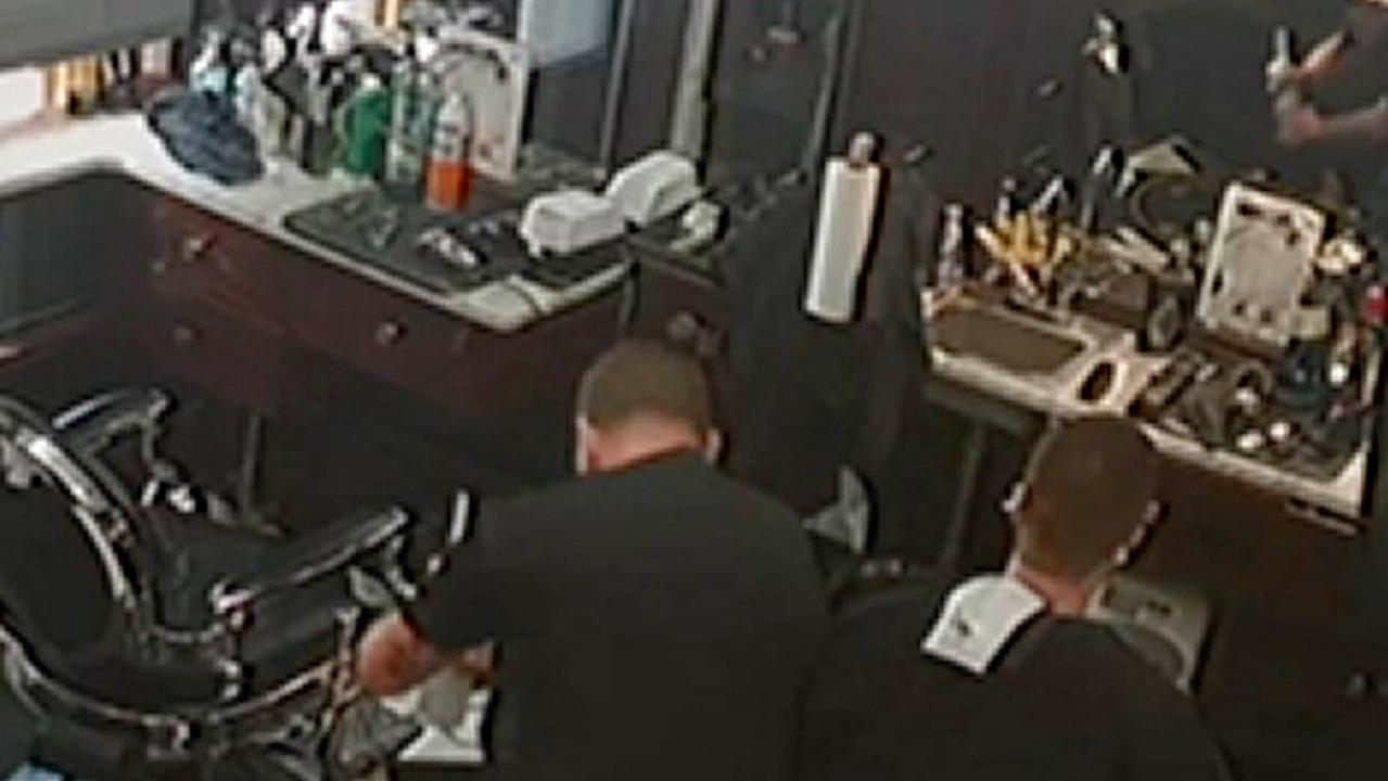 Steve Silva, seen here in camera footage on the left, was gripping 6-and-half-inch professional-grade shears during the accident. Picture: Boston Barber Co.