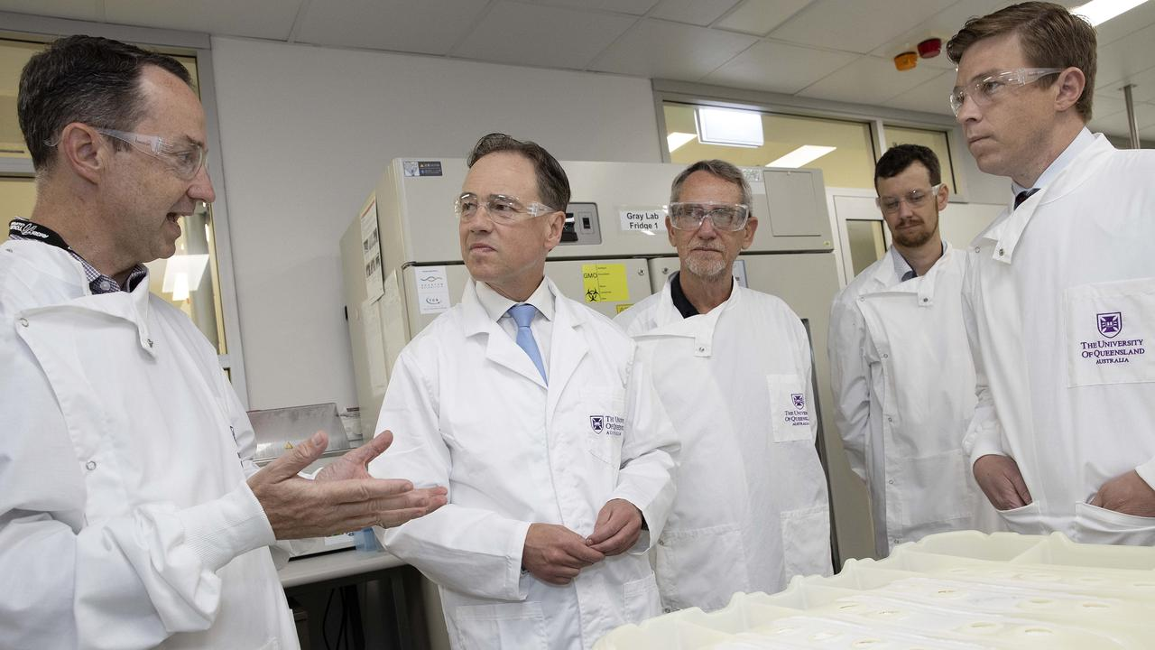 Federal Health Minister Greg Hunt MP (second left) speaks with Professor Trent Munro (left) during a visit to the National Biologics Facility at the University of Queensland, St Lucia. The university is in phase 1 of clinical trials for the COVID 19 vaccine. Picture: NCA NewsWire / Sarah Marshall