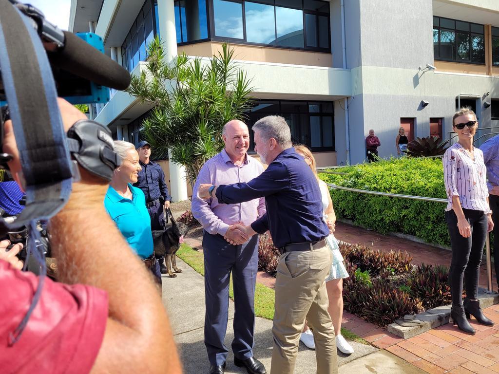 Sunshine Coast CIB officer-in-charge Detective Senior Sergeant Daren Edwards congratulating his retired colleague Detective Sergeant Graeme Farlow. Picture: Matty Holdsworth