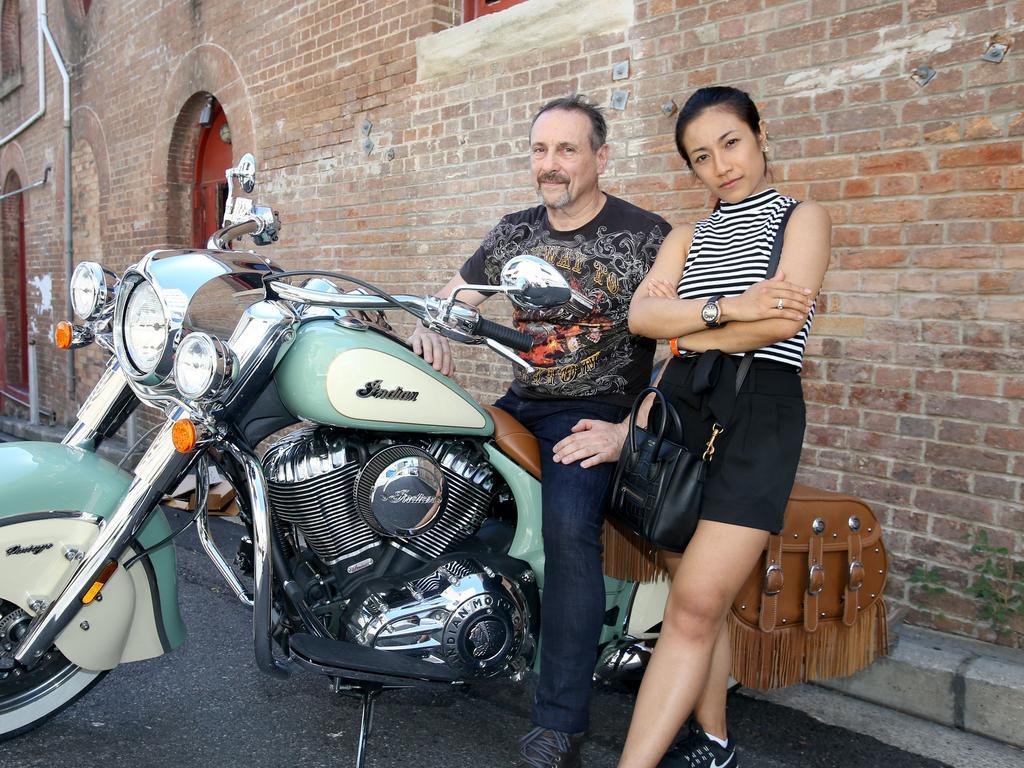 Lev Mizikovsky (left) with girlfriend Manlika Winothai (right), from Petrie Terrace.AAP Image/Steve Pohlner
