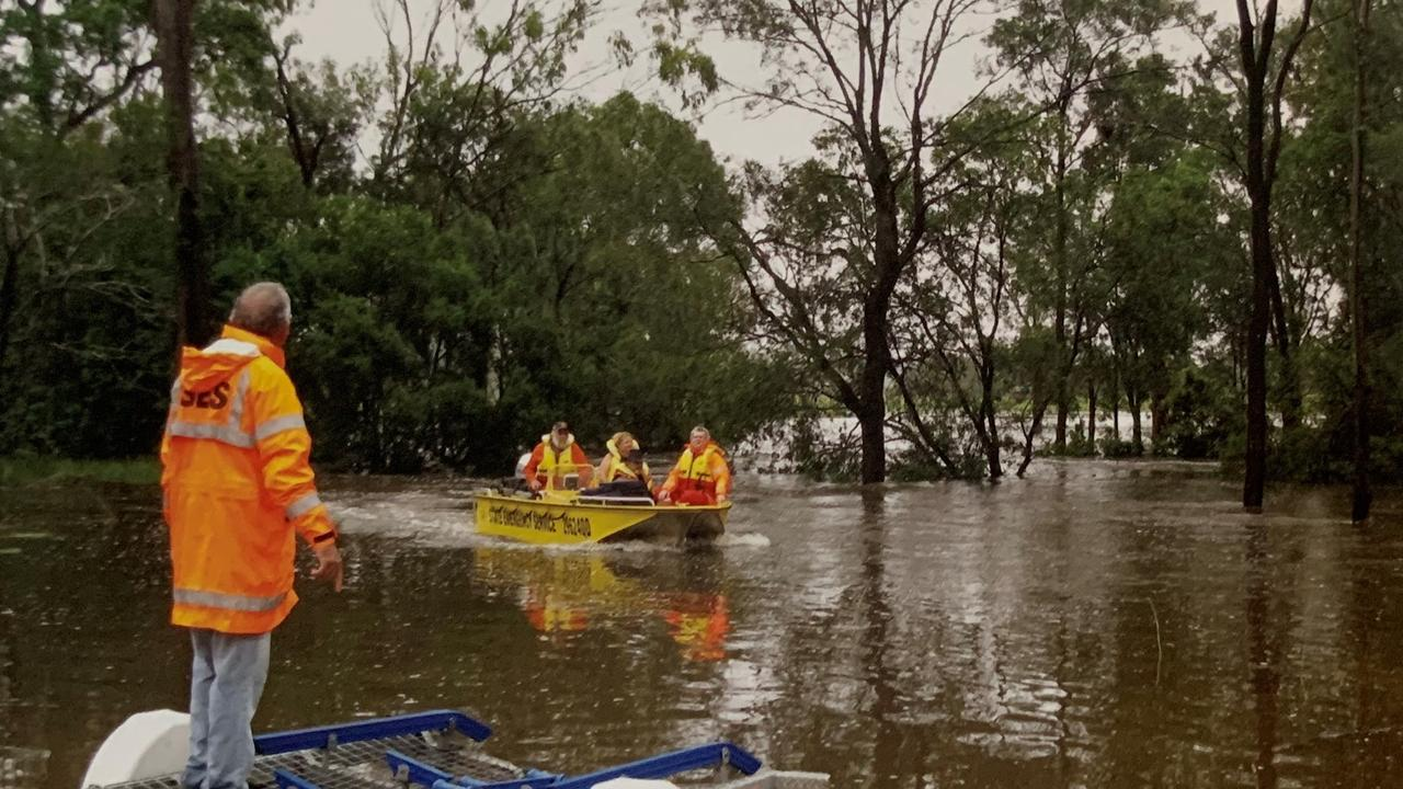 Doug Savage (in the boat) helping bring people in during the Bororen Floods.