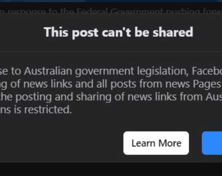 A message greeting Facebook users trying to share now banned news content.