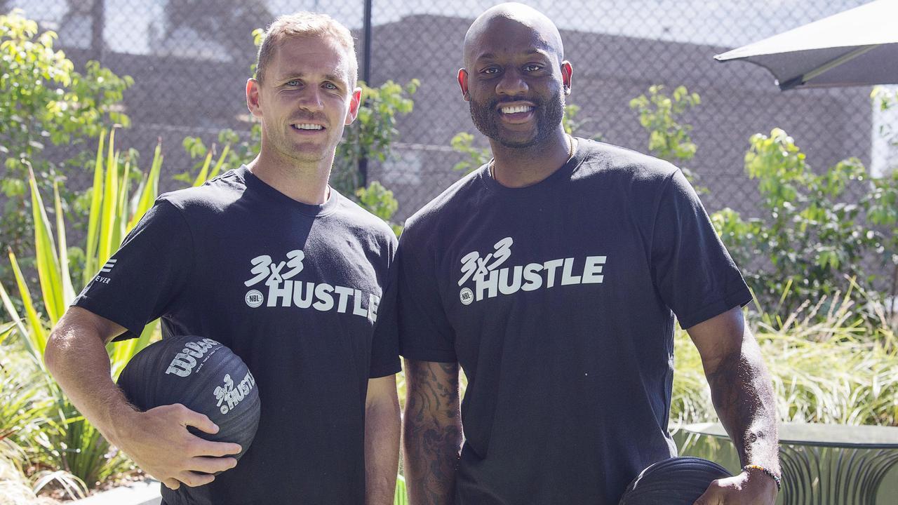 Joel Selwood and Basketballer Corey Williams. Picture: Alan Barber