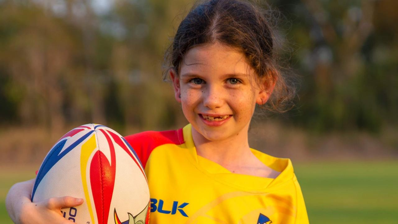 Nine-year-old Lyn-Eve Wood, who has cerebral palsy, has been kicking goals with help from the NDIS.