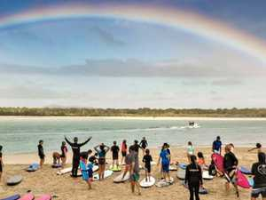 Surf's up as Rainbow Serpent drops in on Noosa kids