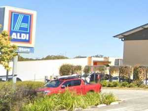 Aldi vacuum 'explodes', burning woman