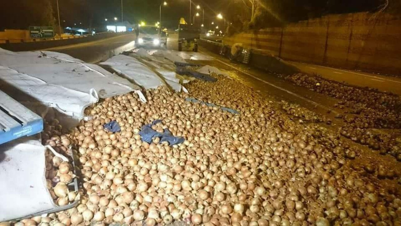 ENOUGH TO MAKE YOU CRY: A B-double dropped its load of onions on the Pacific Hwy in the centre of Coffs Harbour in 2016.
