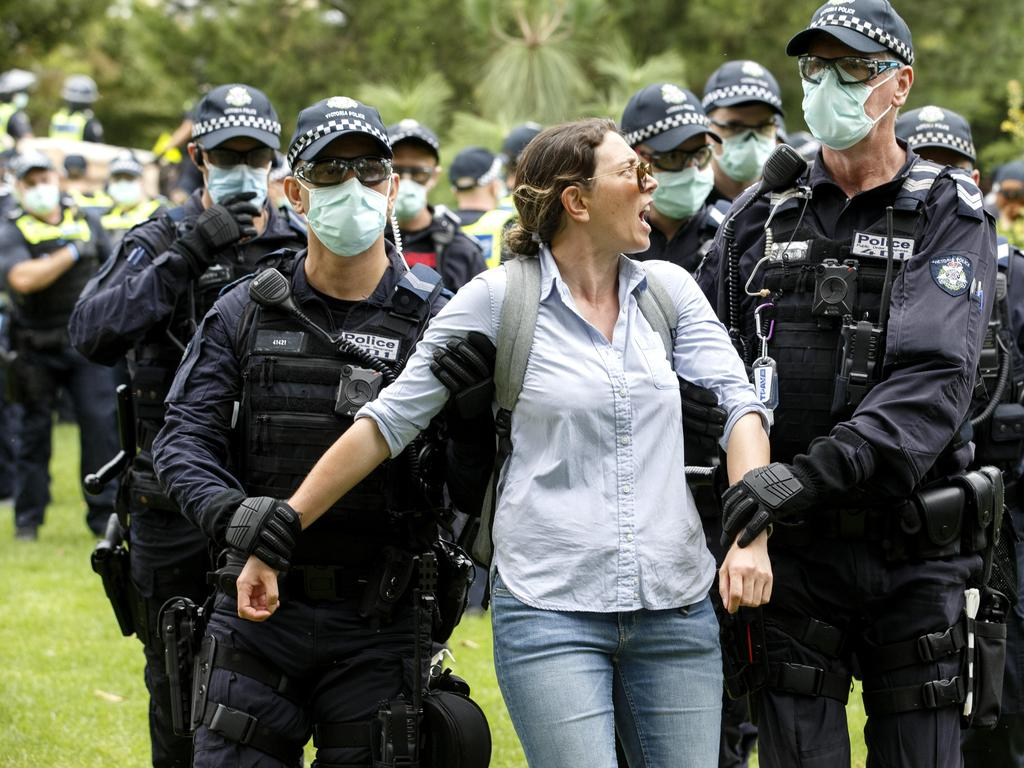 A woman is arrested in Melbourne. Picture: NCA NewsWire / David Geraghty