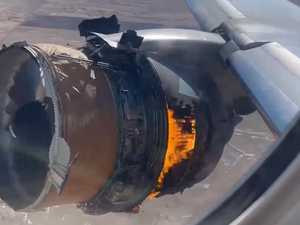 Moment plane's engine bursts into flames