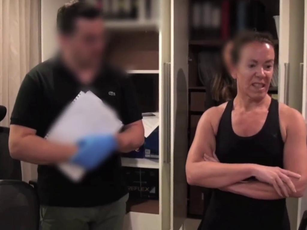 Melissa Caddick stands by as ASIC raids her home last year. Picture: NSW Police