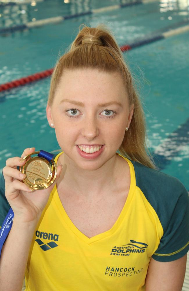 Lakeisha Patterson with the gold medal she won at world para swimming titles. Photo: Alan Quinney