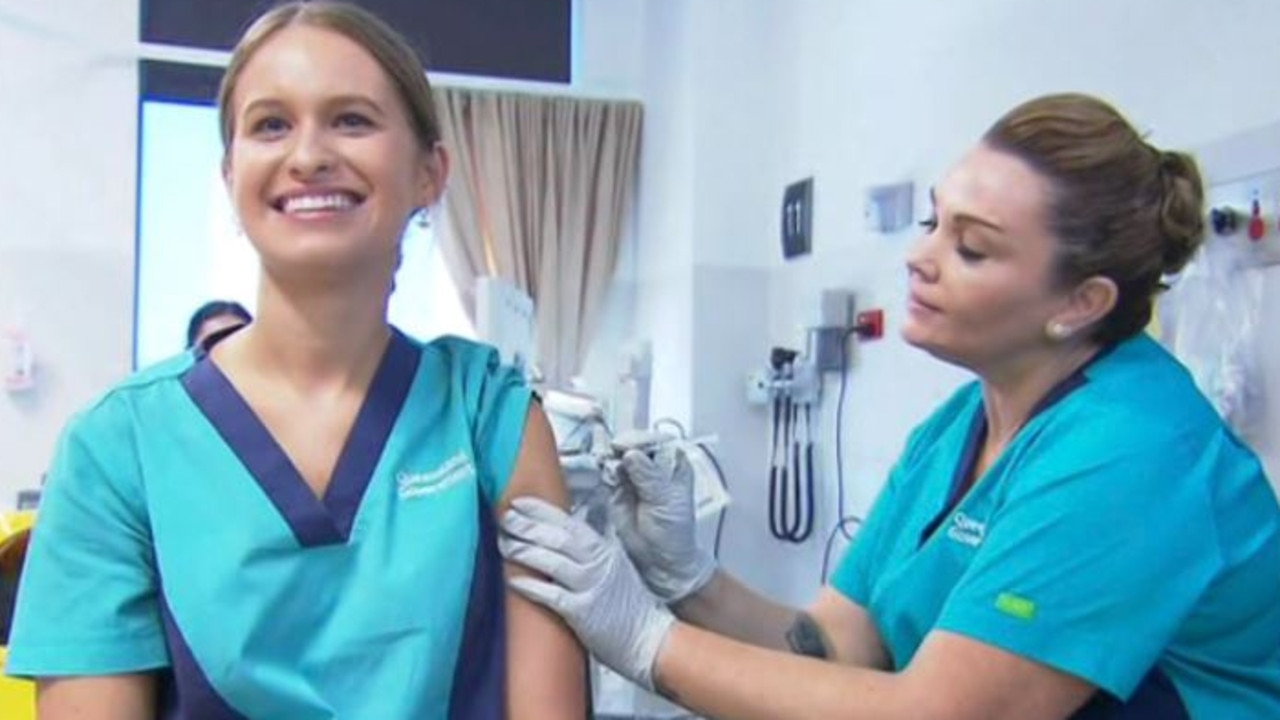 Registered Nurse Zoe Park gets the first COVID-19 jab from clinical nurse consultant Kellie Kenway. Picture: ABC Brisbane