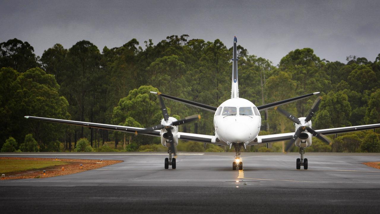 A REX flight arrives at Grafton airport.