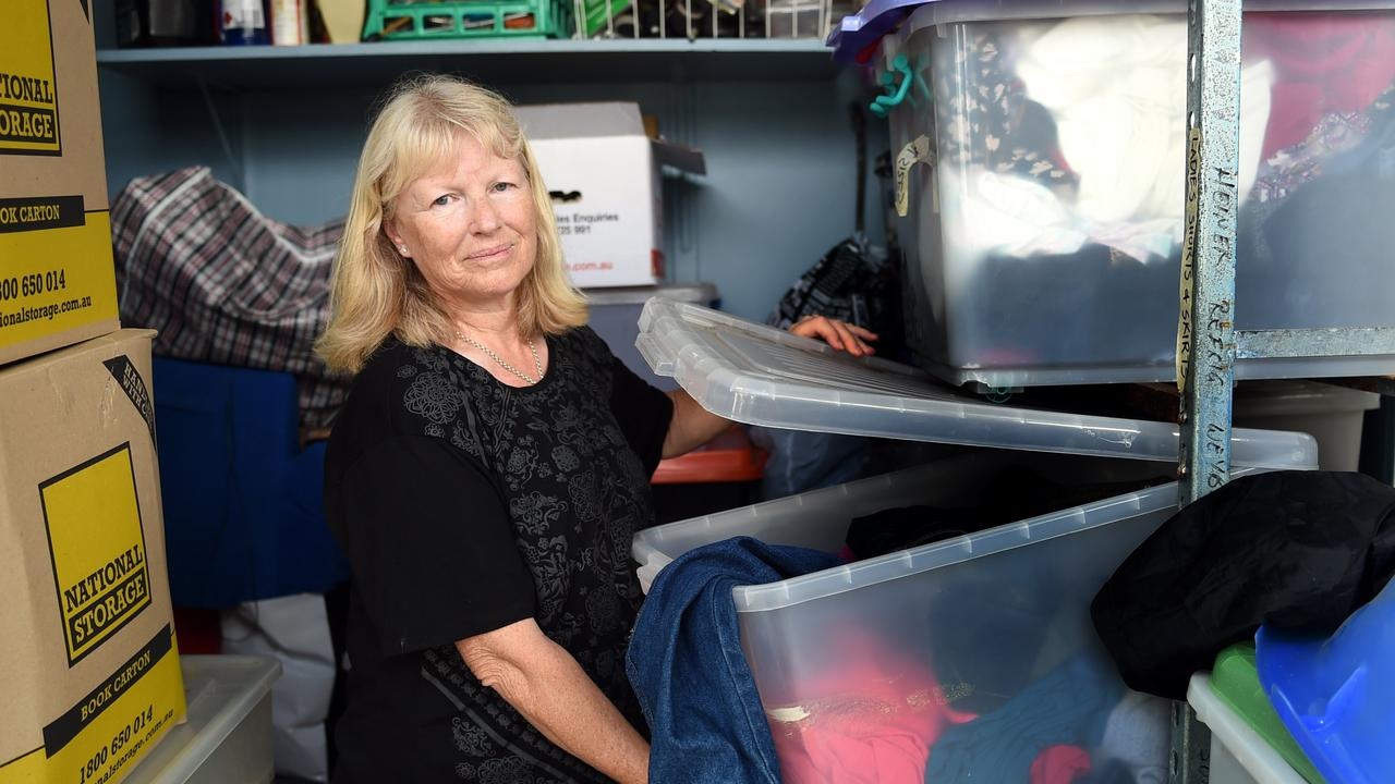 Caboolture Community Action president Sharin Geeves sorts through some of their stock. Photo Vicki Wood / Caboolture News