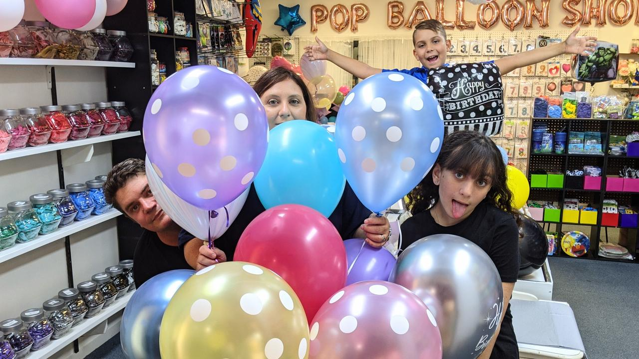 Bradley and Katrina Drinnan and their children Joseph, 10 and Ella, 15, have opened Pop Balloon Shop at Golden Beach.