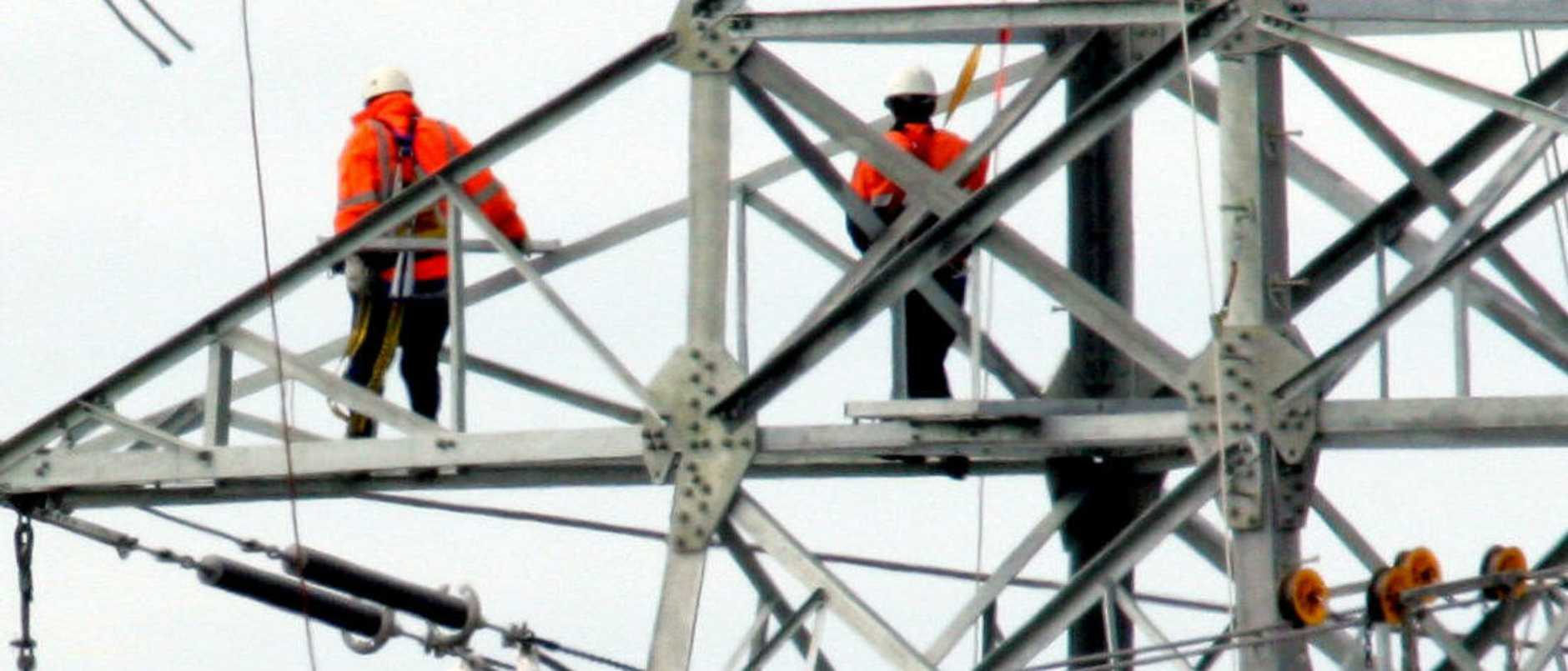 06 Sept 2005 Powerlink workers high up on new transmission towers as they build a high voltage powerline from the Murarrie Sub Station - PicBruce/Long electricity power construction tower