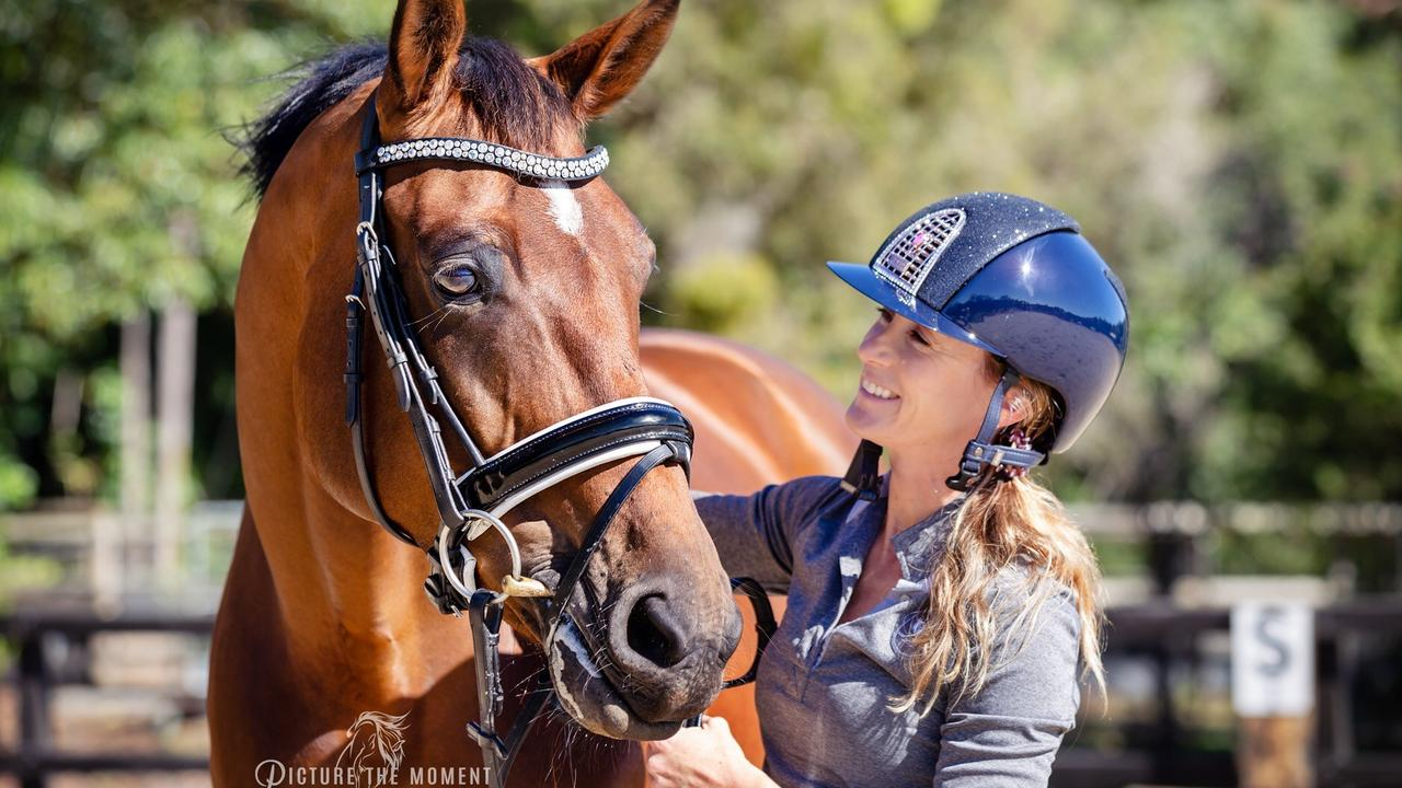 Sports and Spinal Physiotherapy employee Dani Keogh pictured with her horse. Picture: Supplied.