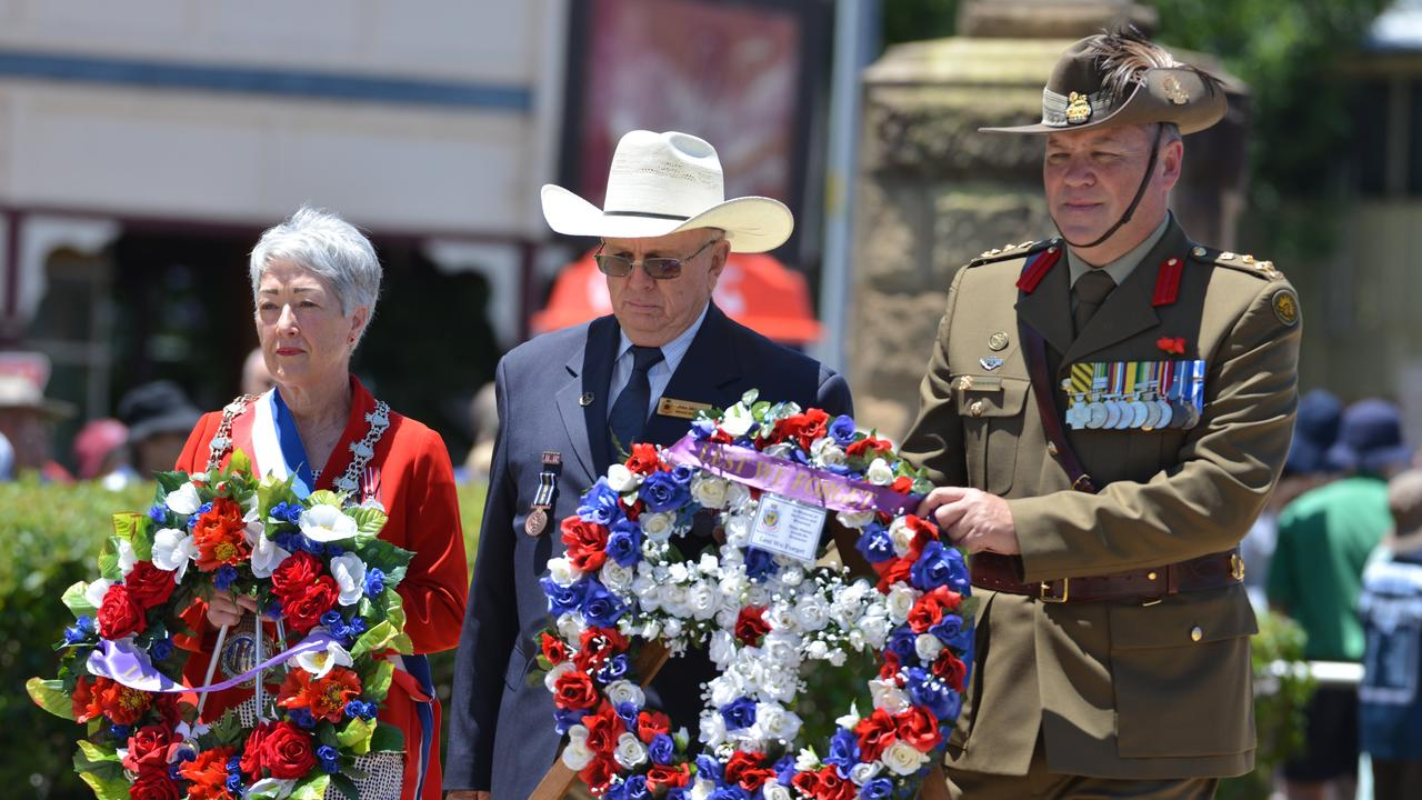 Former Mayor Tracy Dobie (Southern Downs Regional Council), Warwick RSL Sub-branch president John Skinner and Brigadier Duncan Hawyard walk to the cenotaph on Remembrance Day 2019. Picture: Gerard Walsh / Warwick Daily News