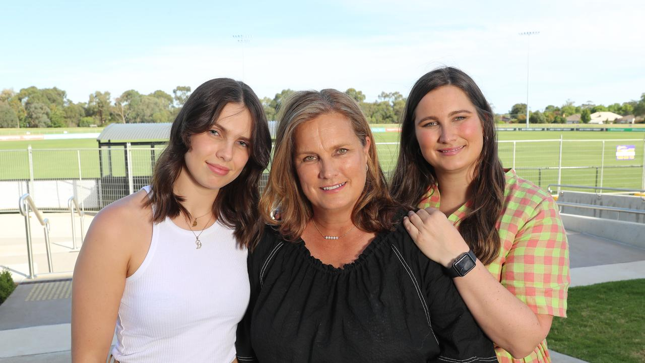 Anita Frawley, with daughters Danielle and Chelsea, is backing more research into CTE. Picture: Alex Coppel