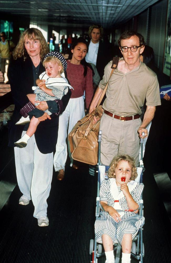 Mia Farrow and Woody Allen, with Farrow's adopted daughter Soon-Yi Previn walking behind. Picture: Charge
