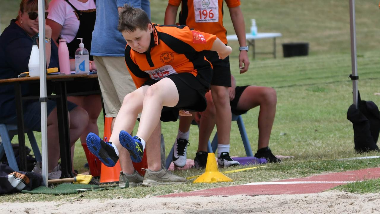 An Ipswich Little Athletics Centre jumper heads for the sand at the recent day one championships at Bill Paterson Oval. Picture: Gary Reid