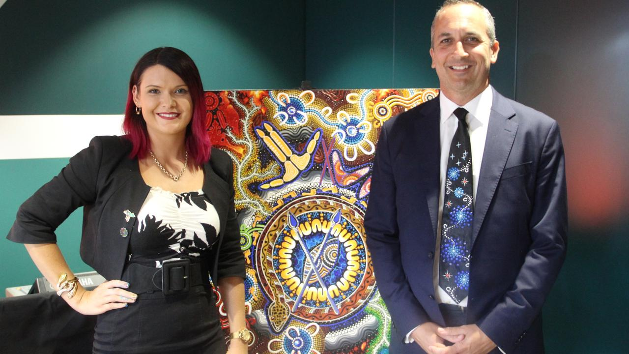 Chern'ee Sutton and NRL CEO Andrew Abdo wearing a hand painted tie by Chern'ee.