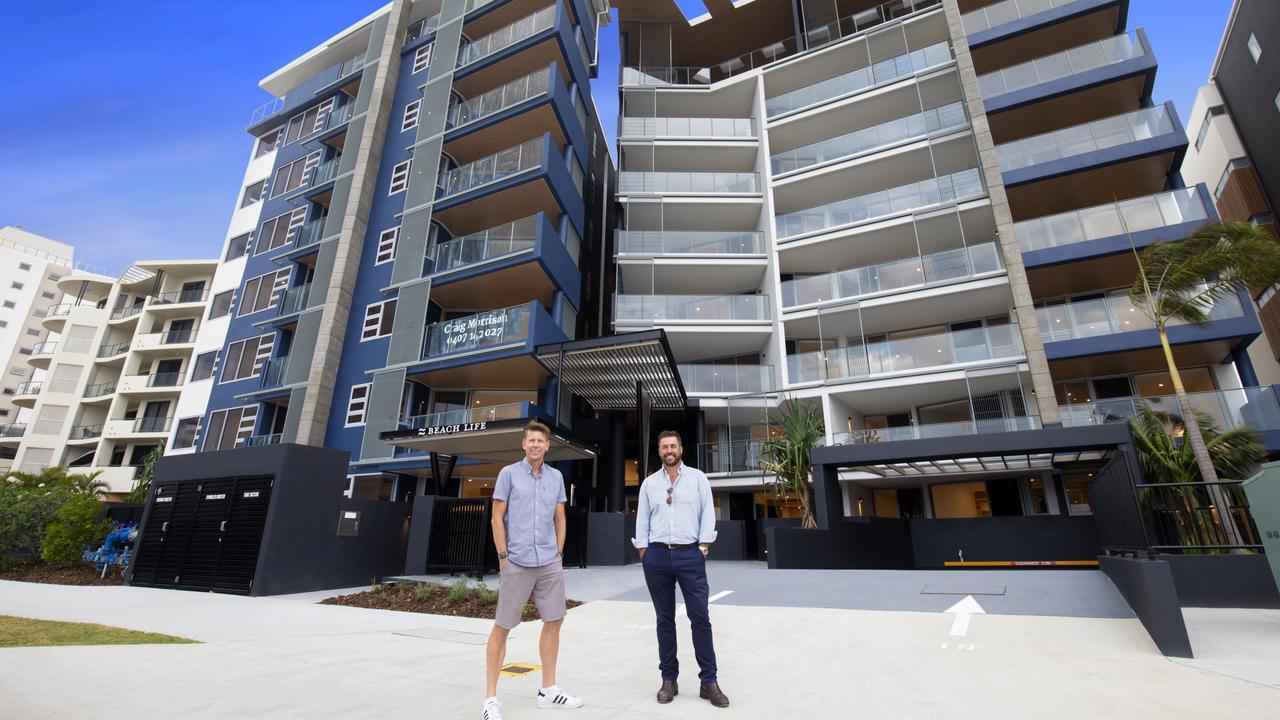 Cube Developments Director Scott Juniper and McNab Sunshine Coast General Manager Carl Nancarrow outside the Beach Life complex at Alexandra Headland.