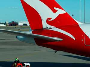Qantas posts first half loss of $1 billion