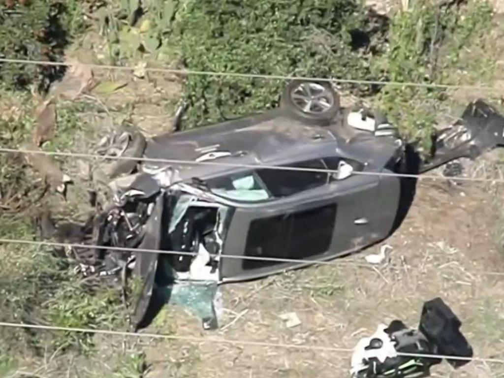Aerial shots showed the horrific damage to Woods' car.