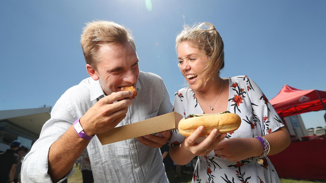 TASTY: Sam Lyons and Isabella Staal enjoying the food at the 2017 BBQ and Beer Roadshow, coming to Warwick this weekend. Pic Peter Wallis